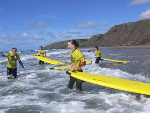 Children learning to surf